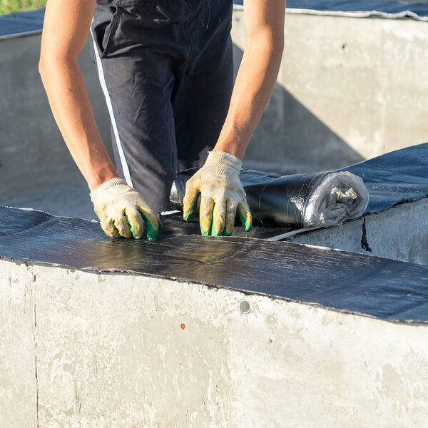 waterproofing of the foundation for the construction of a house made of wood.