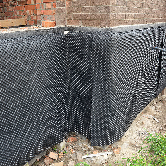 house foundation insulation details with waterproofing bitumen membrane, damp proofing.