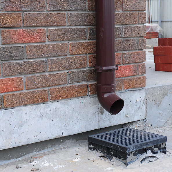 rain gutter system on your house is designed to catch and remove water from the roof and the down spouts are to direct the column of water away from the foundation.